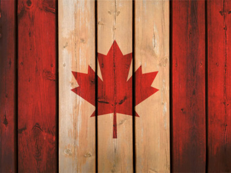 Canadian Flag set against reconditioned wood background